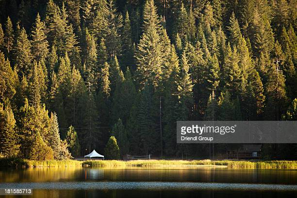 Cabin on the shore of a mountain lake.