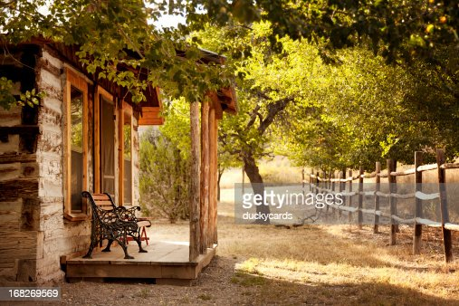 Cabin Porch with Trees and Fence