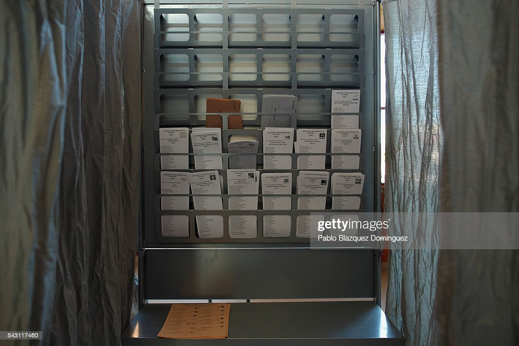 A cabin with voting papers stand inside a polling station during the Spanish General Elections on June 26, 2016 in Madrid, Spain. Spanish voters head back to the polls after the last election in December failed to produce a government. Latest opinion polls suggest the Unidos Podemos left-wing alliance could make enough gains to come in second behind the ruling center right Popular Party.
