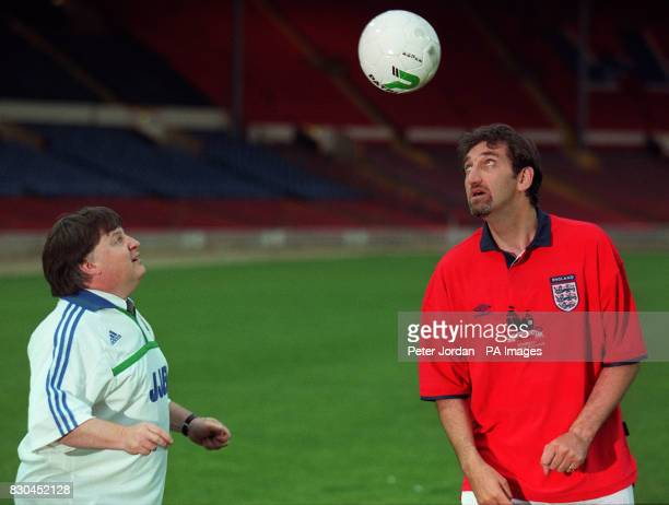 Cabinet Minister Ian McCartney and actor Jimmy Nail get their heads together at London's Wembley Stadium before a match between cabinet ministers and...