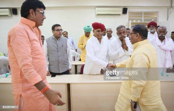 Cabinet Ministers Arun Chaturvedi and Rajendra Rathore exchange greetings with a delegation of Gujjar leaders led by Col Kirori Singh Bainsla before...