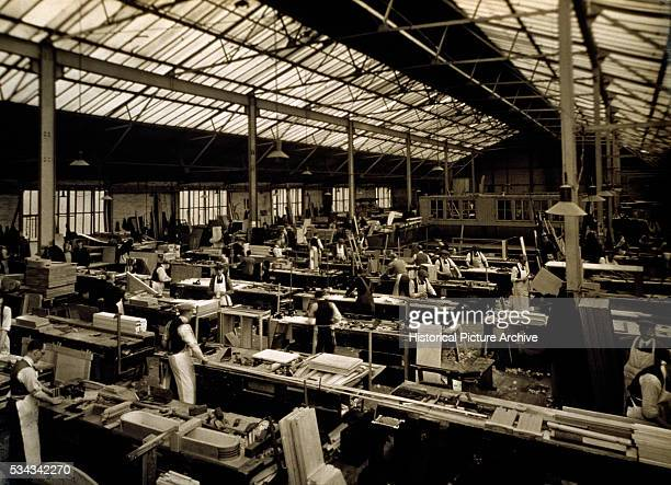 Cabinetmakers work on building cabinets for the ocean liner Mauritania at dockyards in England