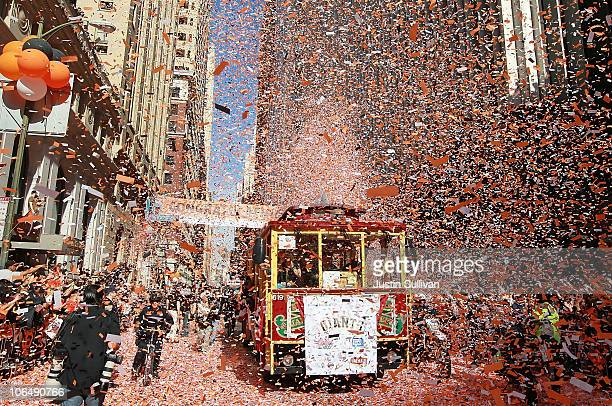 A cable car carrying members of the San Francisco Giants gets covered with confetti during the Giants' vicotry parade on November 3 2010 in San...