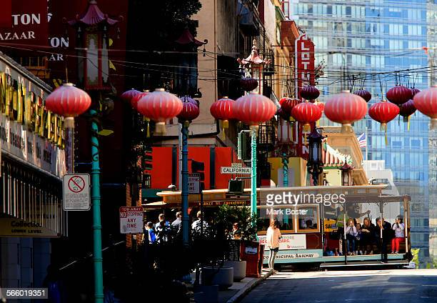 A cable car cruises past Chinatown on a quiet morning in San Francisco June 19 2013 The cable cars are an iconic part of the San Francisco landscape...