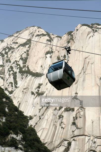 A cable car is seen over the Huashan Mountain on October 18 2009 in Huayin Shaanxi Province China Huashan located at an altitude of 21549 meters in...