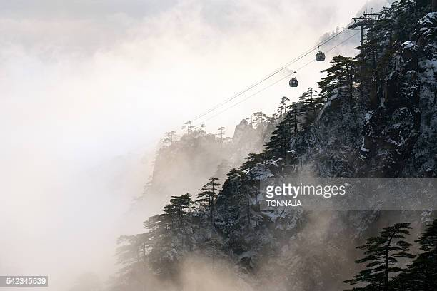 Cable car on Huangshan mountain in foggy day