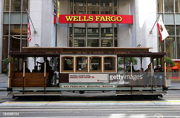 A cable car passes by a Wells Fargo bank on October 11 2013 in San Francisco California Wells Fargo reported a 13 percent increase in thirdquarter...