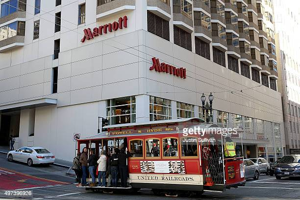 A cable car passes in front of a Marriott hotel on November 16 2015 in San Francisco California Marriott International announced plans to purchase...