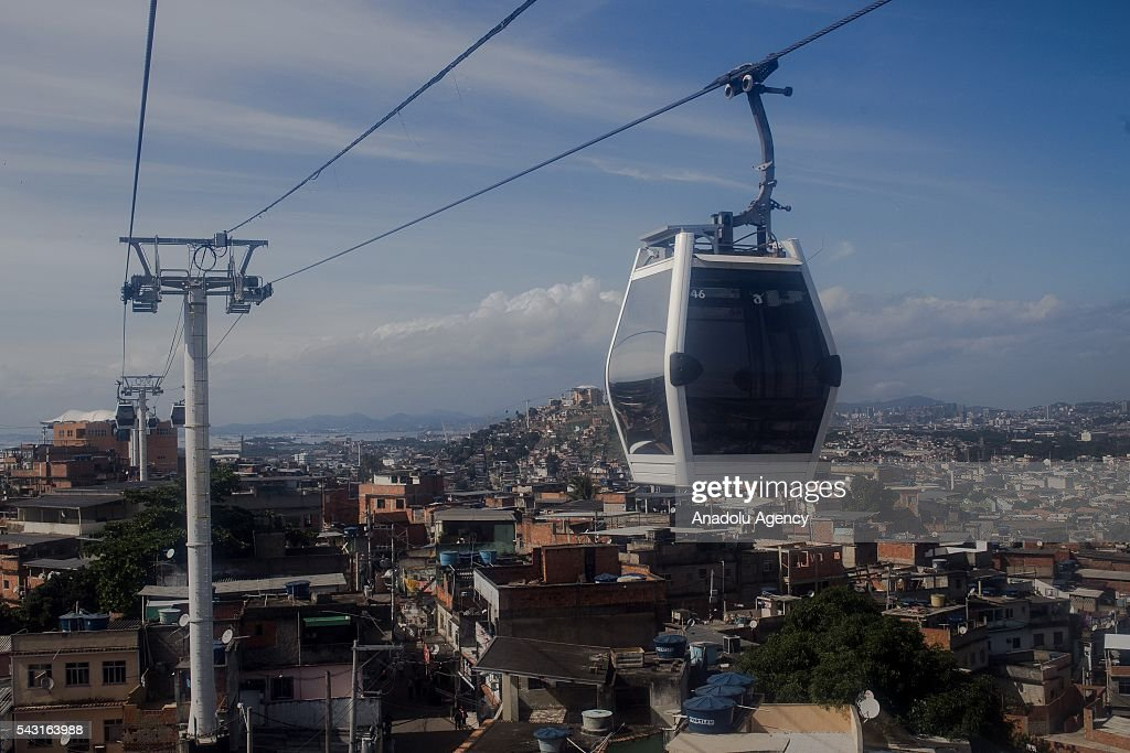 A cable car transports commuters over homes in the Alemao Complex, Morro do Alemao is seen in Rio de Janeiro, Brazil on June 26, 2016.