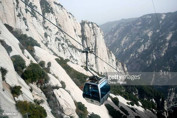 A cable car travels up the Huashan Mountain on October 18 2009 in Huayin Shaanxi Province China Huashan located at an altitude of 21549 meters in the...