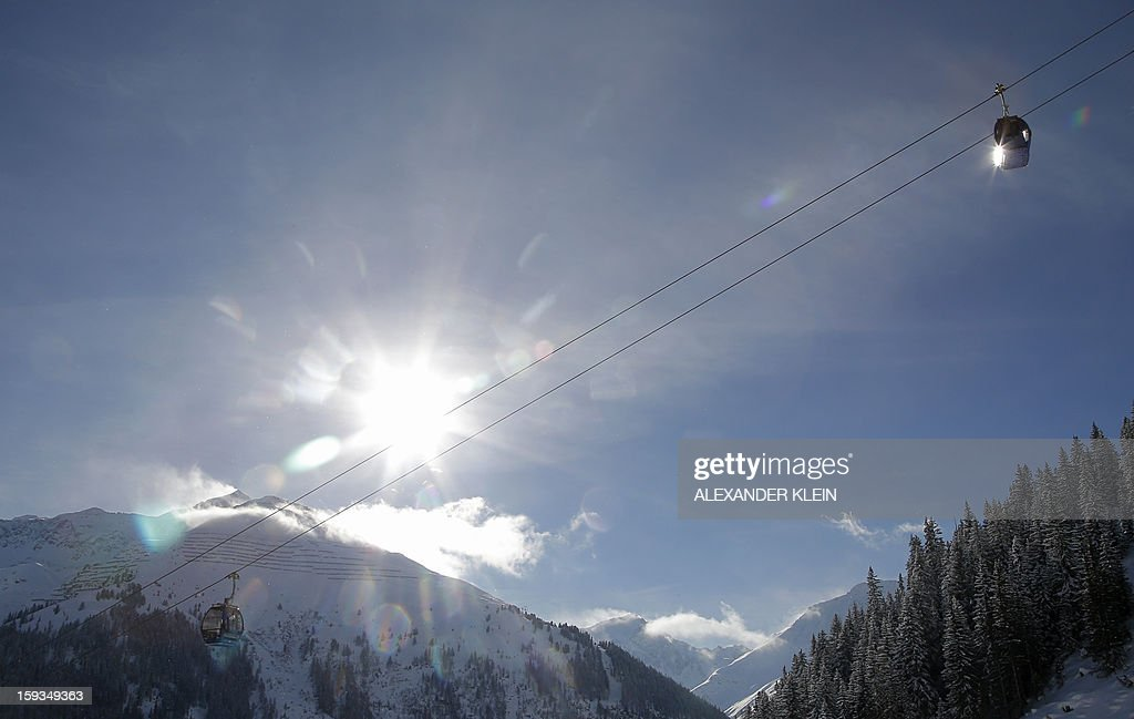 Cable cars are seen in the mountains of Sankt Anton am Arlberg Austria on January 12 2013 AFP PHOTO / ALEXANDER KLEIN
