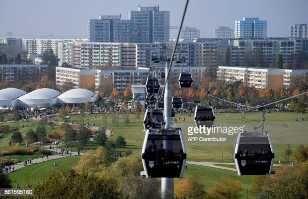 Cable cars of a funicular make their way over the grounds of the International Garden Exhibition in Berlin during the show's last day on October 15...