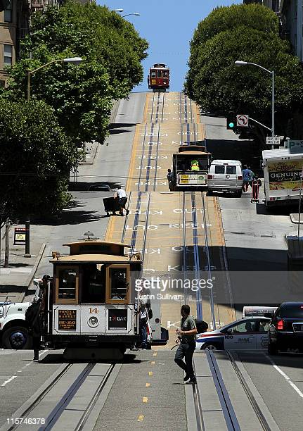 Cable cars travel along Powell Street on June 9 2011 in San Francisco California Beginning on July 1 the price for a ride on San Francisco's famed...