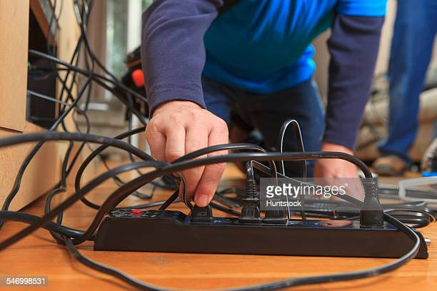 Cable installer putting plugs into power source