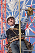 Cable lineman climbing a ladder to repair transmission line