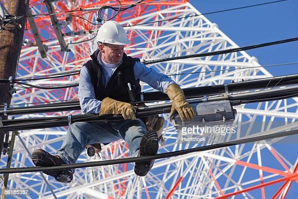Cable lineman repairing distribution box