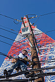 Cable lineman repairing transmission line