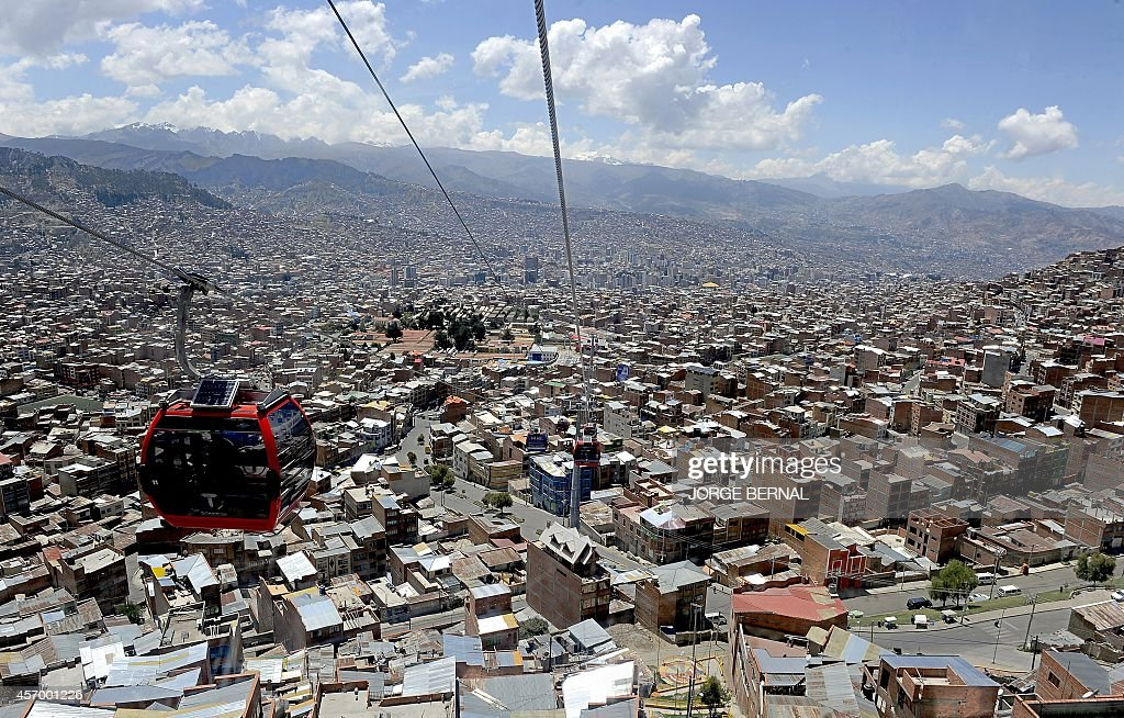 A cablecar is seen over La Paz considered the highest project of its kind moving at over 4000 meters above sea level on October 10 two days before...