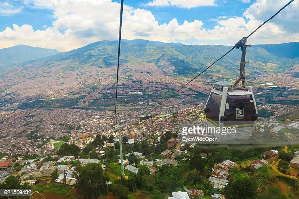 Cablecars of the Metrocable a gondola lift system that links the city with the neighborhoods and suburbs in the mountains on August 27 2016 in...