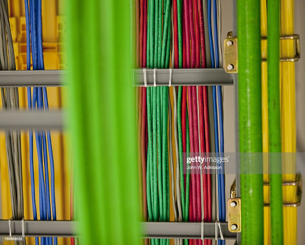 Cables hang in the 4G equipment area at an AT&T mobile telephone switching office on October 25, 2012 in Charlotte, North Carolina. The center handles wireless AT&T traffic from the western part of North Carolina.
