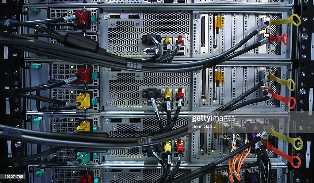 Cables lead to the components of an IBM XIV Storage Sytem at the IBM stand at the 2013 CeBIT technology trade fair the day before the fair opens to visitors on March 4, 2013 in Hanover, Germany. CeBIT will be open March 5-9.