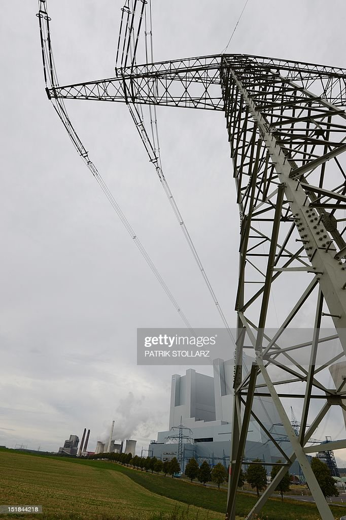 Cables of a power pole connect to the new Neurath lignit coal-fired RWE power station on September 11, 2012 at Grevenbroich near Aachen, western Germany. RWE, one of Germany's major energy provider, invested in new coal conducted power plants. AFP PHOTO / PATRIK STOLLARZ