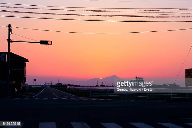 Cables Over Road Against Sky During Sunset