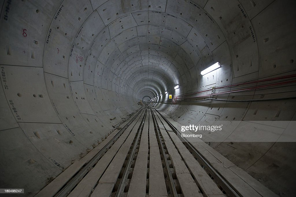 Cables run along a finished section of the Tunnel Emisor Oriente (TEO), or Eastern Discharge Tunnel, during construction of the 38 mile (62km) underground wastewater treatment tunnel in Mexico City, Mexico, on Thursday, Sept. 12, 2013. The tunnel, which is expected to be completed in 2014, will boost Mexico City's drainage capacity to help prevent flooding during rainy season and the over-exploitation of groundwater resources. The project is being managed by Mexico's National Water Commission, Conagua. Photographer: Susana Gonzalez/Bloomberg via Getty Images