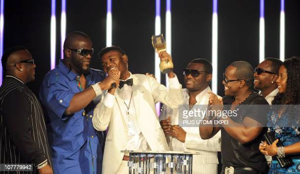 Cabo Snoop of Angola surrounded by Lusophone artists holds on December 11 2010 the Best Lusophone award at the MTV Africa Music Awards ceremony in...