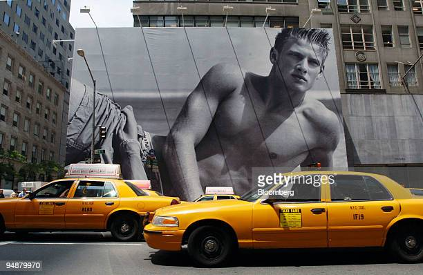 Cabs drive in front of a billboard surrounding the future home of a new Abercrombie Fitch store Thursday June 2 2005 in New York Gasoline prices near...