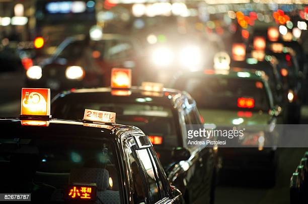 Cabs on Shijo Dori St at dusk, Kyoto
