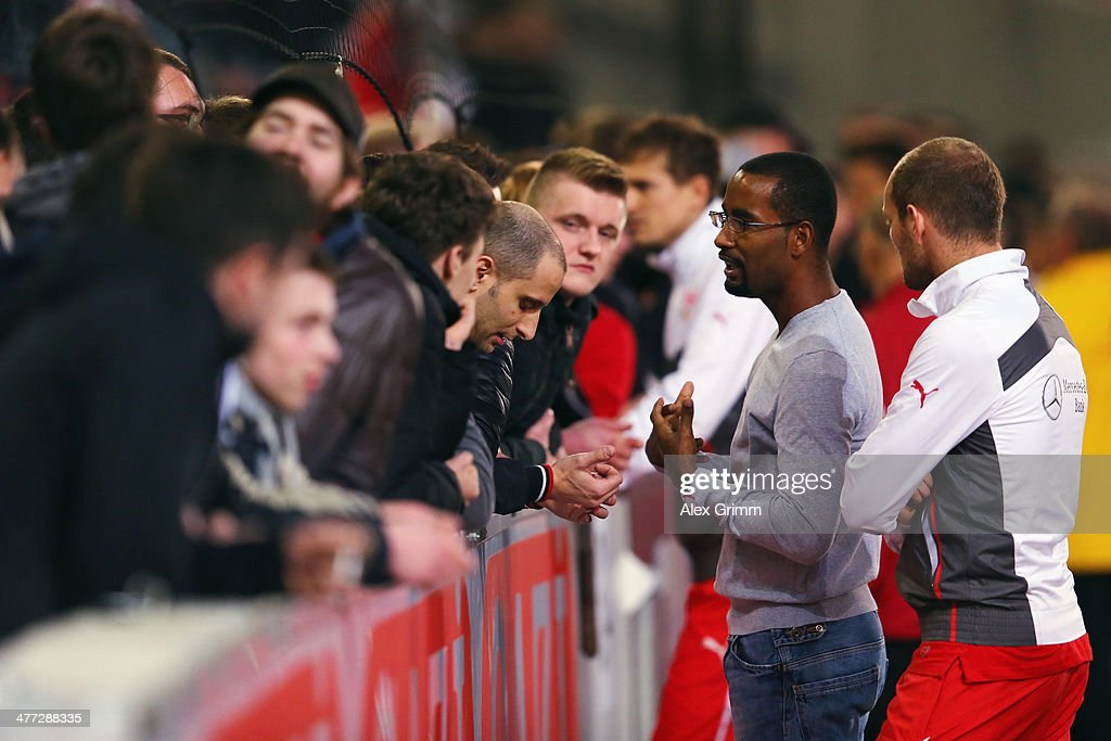 Cacau and Konstantin Rausch of Stuttgart discuss with the fans after the Bundesliga match between VfB Stuttgart and Eintracht Braunschweig at...