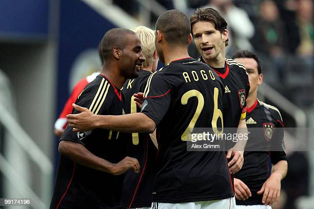 Cacau of Germany celebrates his team's first goal with team mates Dennis Aogo and Arne Friedrich during the international friendly match between...