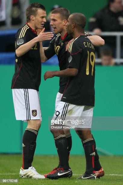 Cacau of Germany celebrates the second goal with Kevin Grosskreutz and Lukas Podolski during the international friendly match between Germany and...
