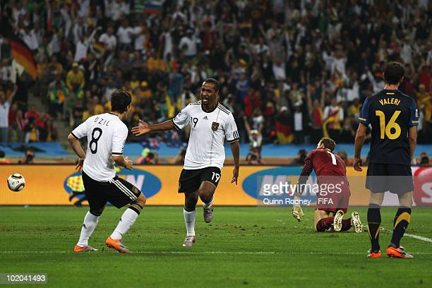 Cacau of Germany celebrates with team mate Mesut Oezil scoring his side's fourth goal while goalkeeper Mark Schwarzer of Australia can just watch on...