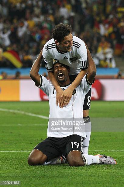 Cacau of Germany celebrates with team mate Mesut Oezil scoring his side's fourth goal during the 2010 FIFA World Cup South Africa Group D match...