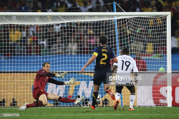 Cacau of Germany scores his side's fourth goal against goalkeeper Mark Schwarzer of Australia during the 2010 FIFA World Cup South Africa Group D...