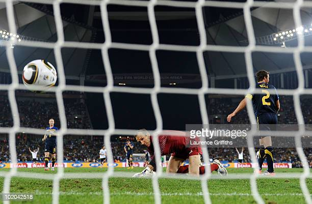 Cacau of Germany scores his side's fourth goal past Mark Schwarzer of Australia during the 2010 FIFA World Cup South Africa Group D match between...