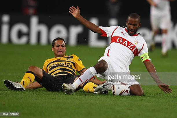 Cacau of Stuttgart battles for the ball with Ammar Jemal of Bern during the UEFA Europa League group H match between VfB Stuttgart and BSC Young Boys...
