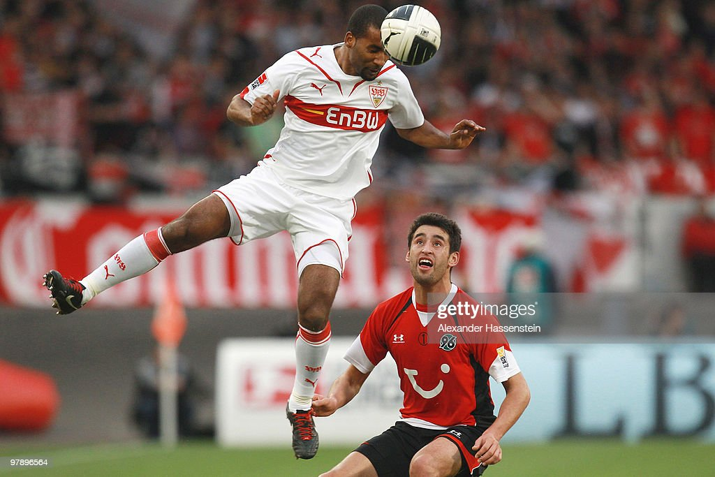 Cacau of Stuttgart battles for the ball with Karim Haggui of Hannover during the Bundesliga match between VfB Stuttgart and Hannover 96 at...