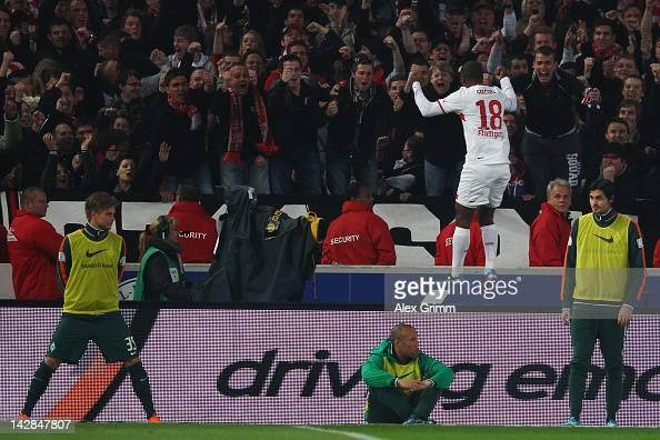 Cacau of Stuttgart celebrates his team's fourth goal between Bremen's substitution players during the Bundesliga match between VfB Stuttgart and SV...