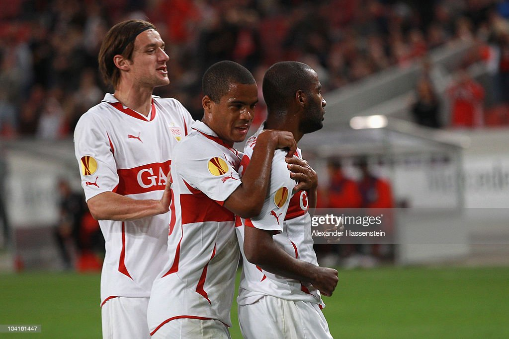 Cacau of Stuttgart celebrates scoring the opening goal with his team mates Daniel Didavi and Christian Gentner during the UEFA Europa League group H...