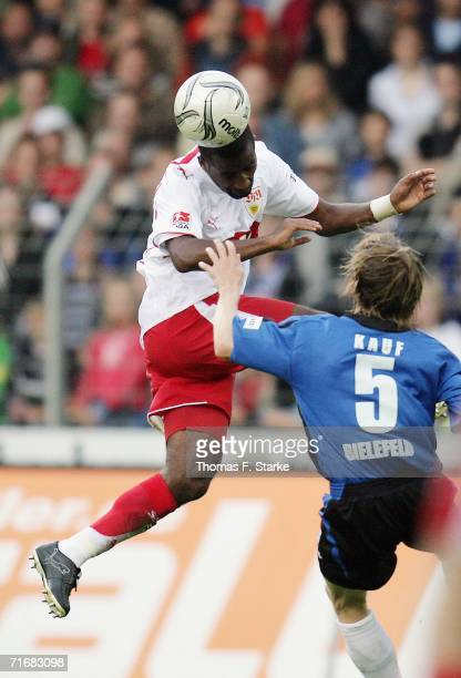 Cacau of Stuttgart heads the ball against Ruediger Kauf of Bielefeld during the Bundesliga match between Arminia Bielefeld and VFB Stuttgart at the...