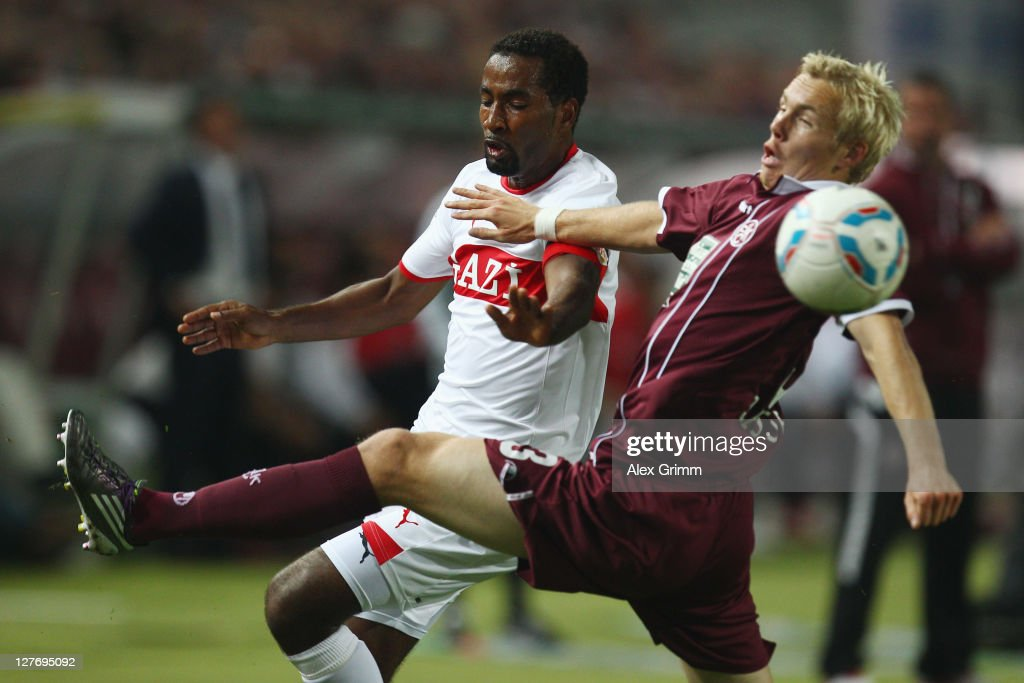 <a gi-track='captionPersonalityLinkClicked' href=/galleries/search?phrase=Cacau&family=editorial&specificpeople=178248 ng-click='$event.stopPropagation()'>Cacau</a> (L) of Stuttgart is challenged by Leon Jessen of Kaiserslautern during the Bundesliga match between between 1. FC Kaiserslautern and VfB Stuttgart at Fritz-Walter Stadium on September 30, 2011 in Kaiserslautern, Germany.