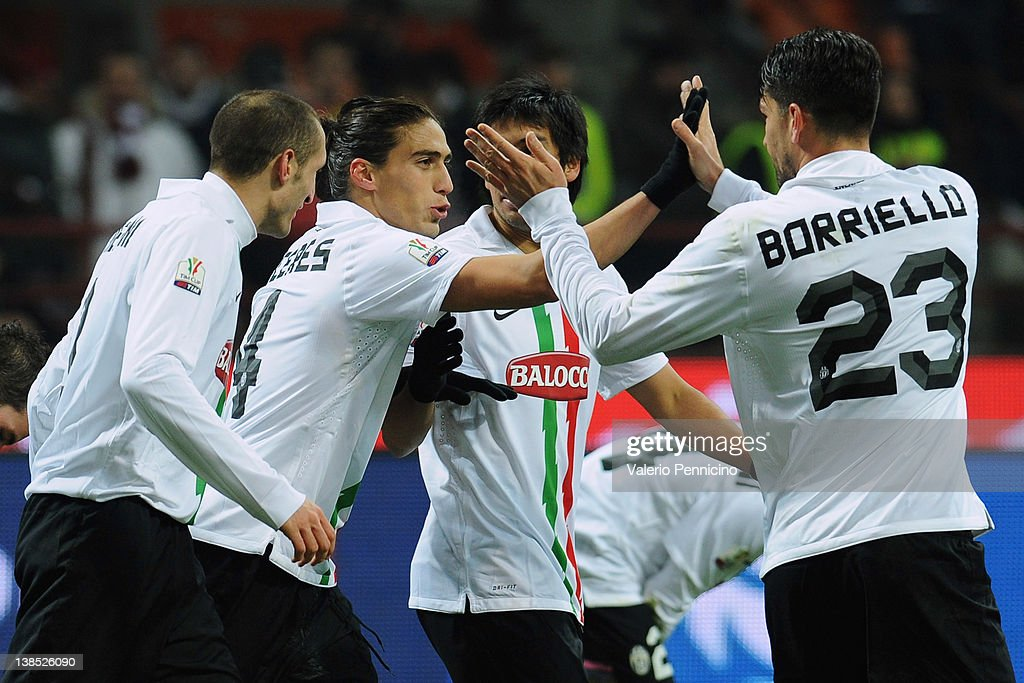 Caceres (2nd L) of Juventus FC celebrates with his team-mates after scoring the opening goal during the Tim Cup match between AC Milan and Juventus FC at Giuseppe Meazza Stadium on February 8, 2012 in Milan, Italy.