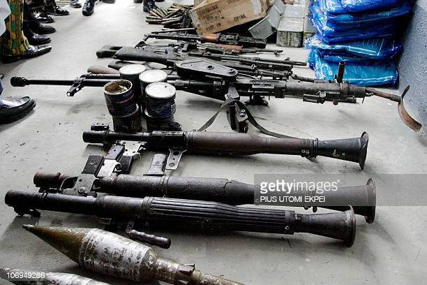 A cache of arms recovered during from Niger Delta militants during an operation to free 19 hostages by the Joint Task Force are displayed in Port...