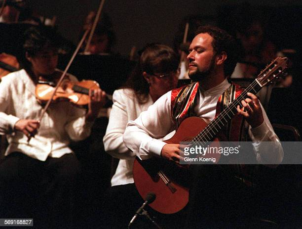CAConcertWilliam0907GK–Guitarist William Kanengiser performs RodrigoÕs Concierto de Aranjuez as conductor Carl St Clair conducts the Pacific Symphony...
