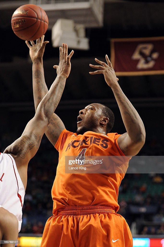 Cadarian Raines #4 of the Virginia Tech Hokies puts up a shot against the North Carolina State Wolfpack during the first round of the 2013 Men's ACC Tournament at the Greensboro Coliseum on March 14, 2013 in Greensboro, North Carolina. NC State defeated Virginia Tech 80-63.