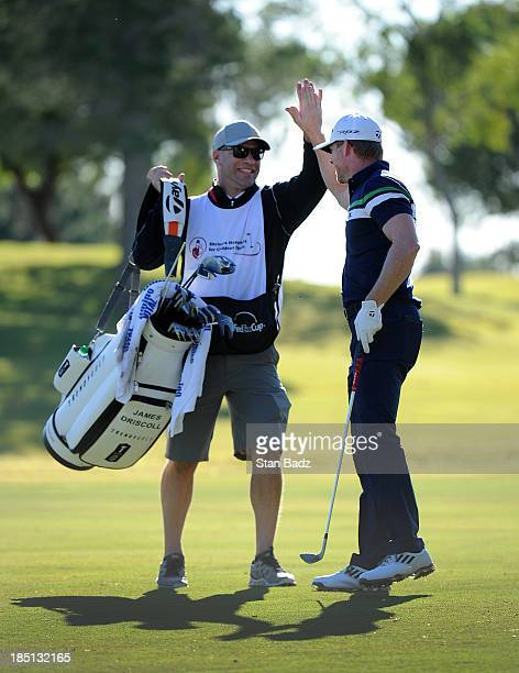 Caddie Andy Barnes celebrates his player James Driscoll after Driscoll holes out from the ninth fairway during the first round of the Shriners...