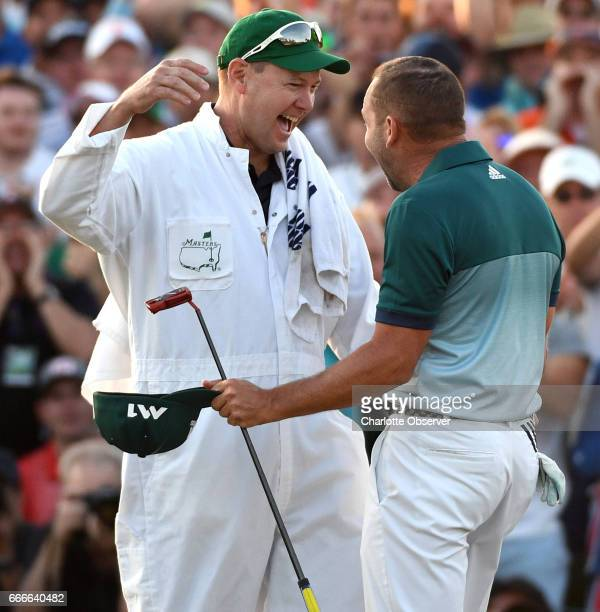 Caddie Glen Murray left embraces Sergio Garcia after Garcia defeated Justin Rose in a onehole playoff on the 18th green on Sunday April 9 2017 at...